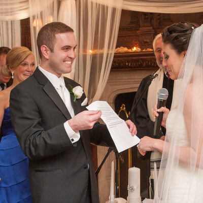 the bride reads her vows under the chuppah
