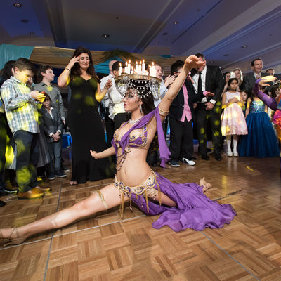 Bar Mitzvah guests entertained by belly dancers