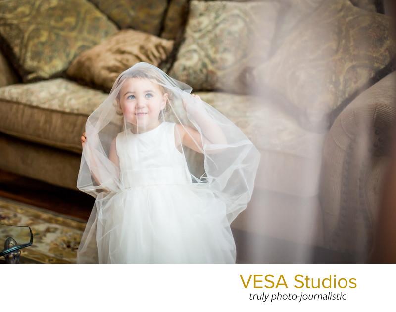 Flower girl imitating the bride