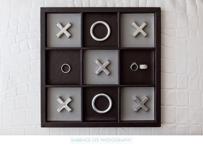 Creative Wedding Ring Photograph on Tic-Tac-Toe Board