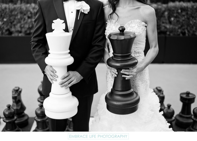 Bride and Groom Holding Giant Chess Pieces