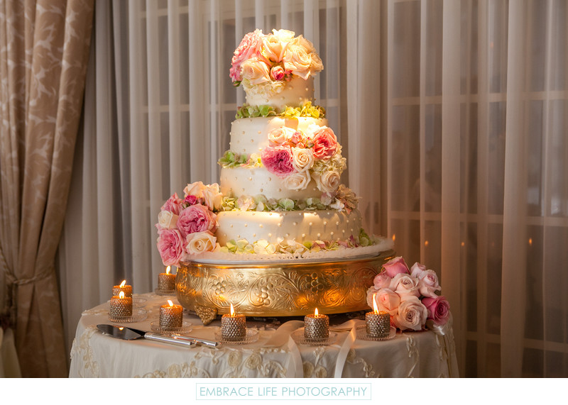 Flower Covered Four-Tier Wedding Cake