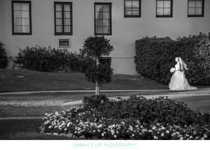 Bride Walking Along Garden Path