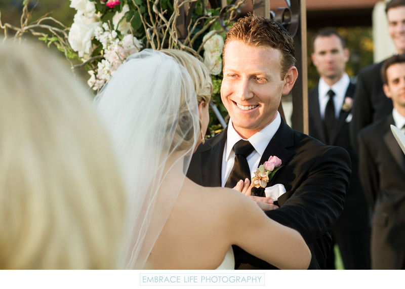 Smiling Groom at Wedding Ceremony