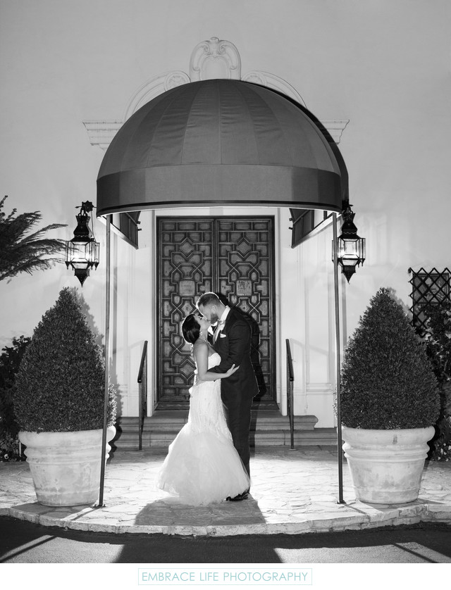 Couple Kissing Outside of Grand Entry Doors