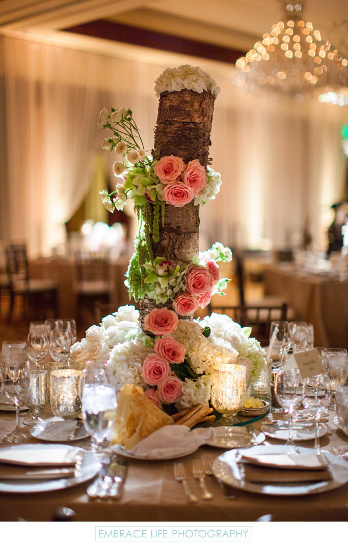 Rustic Wood Centerpiece Draped with Flowers