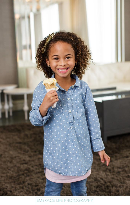 Adorable Girl Holding Ice Cream Cone in Santa Monica