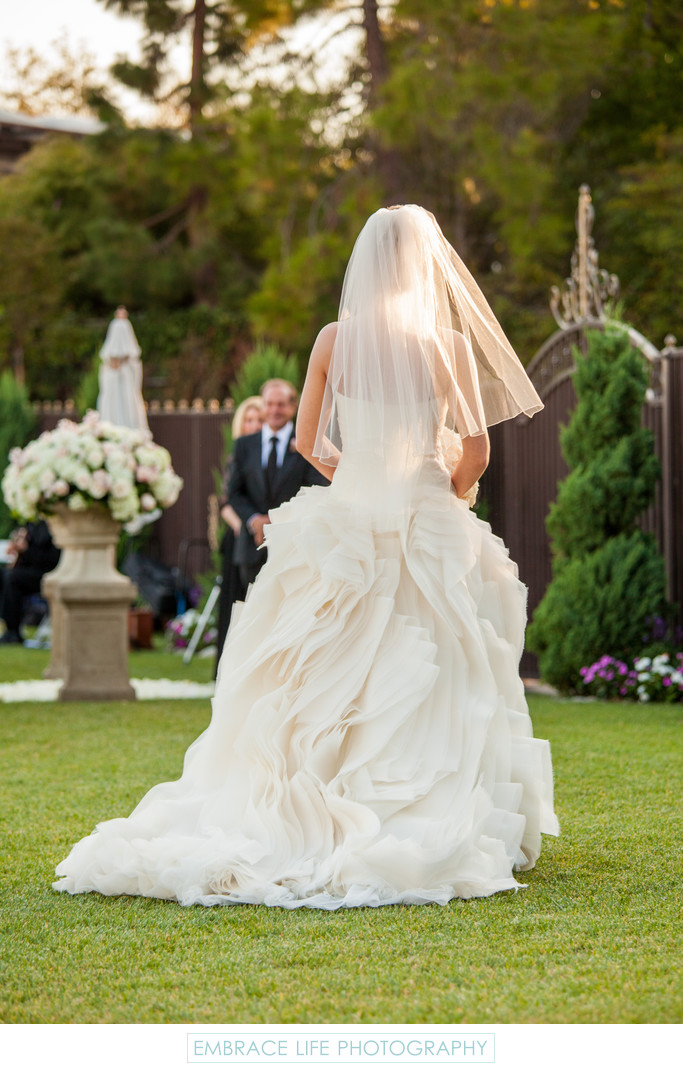 Bride Walking Toward Wedding Aisle
