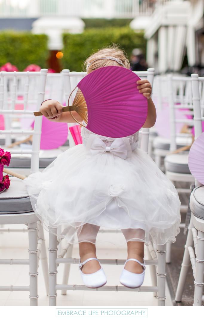 Flower Girl Hides Behind Large Hand Fan
