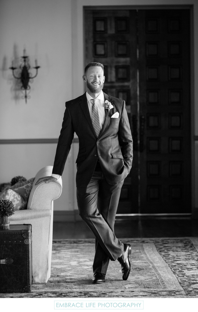 Black and White Wedding Portrait of Smiling Groom