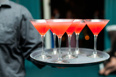 Tray of Pink and Orange Cocktails Being Served