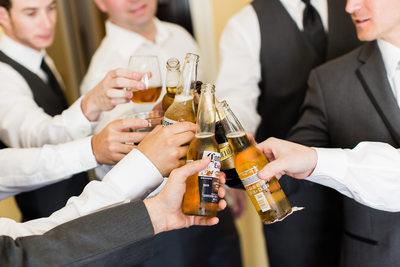 Groomsmen Toasting Beers Before Ceremony