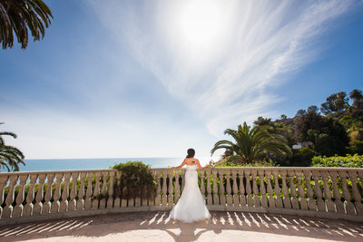 Bride Facing Pacific Ocean at Balustrade