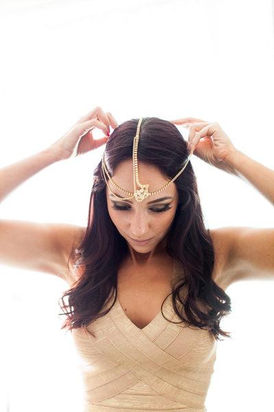 Bridesmaid Putting on Bohemian Hindu Headpiece