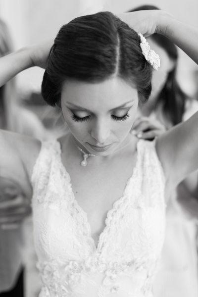 Bride Putting on Wedding Jewelry