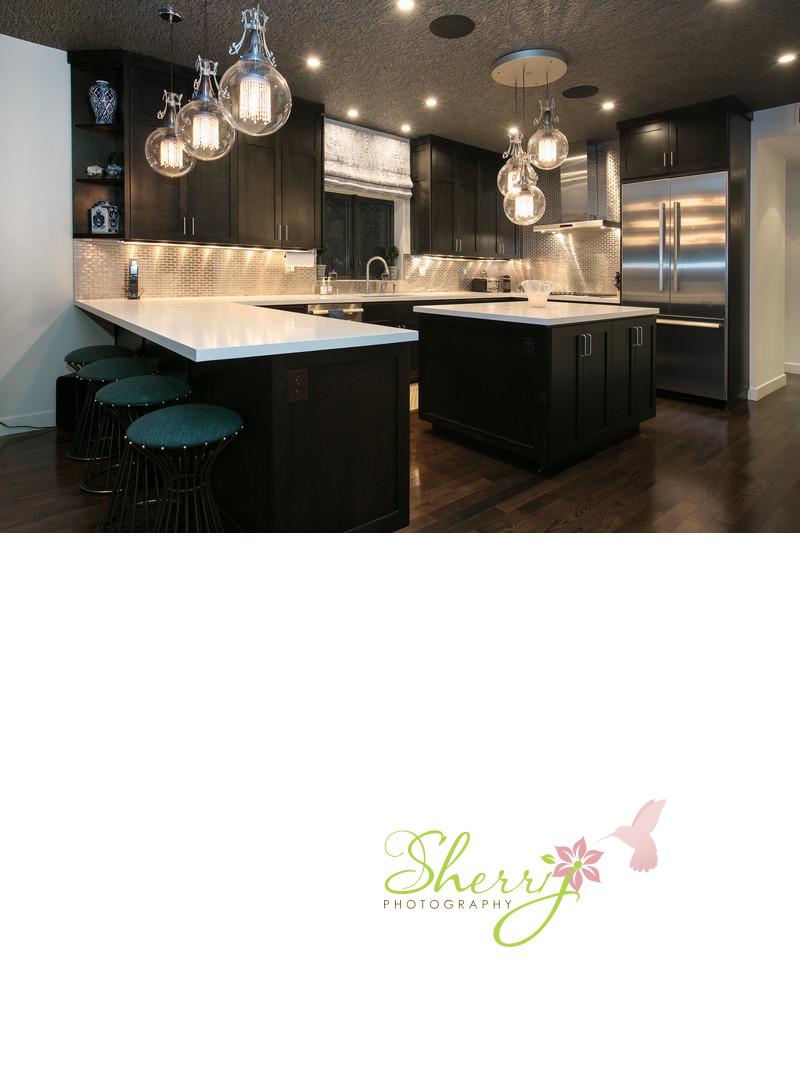 contemporary designer kitchen black cabinet fancy lighting