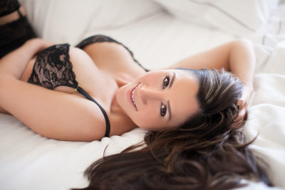 boudoir bed pose with loose hair