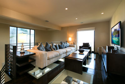 modern media room with glass floors Hollywood Hills