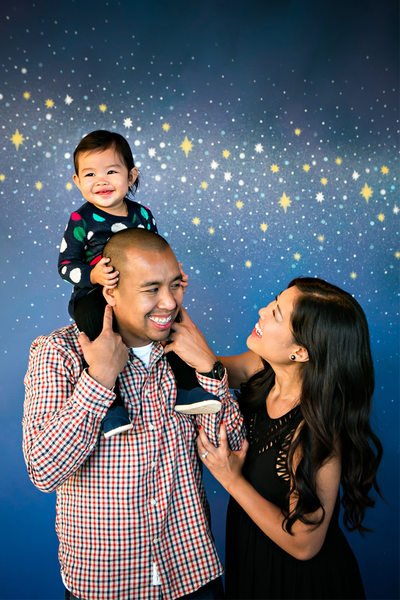 starry wall family portrait