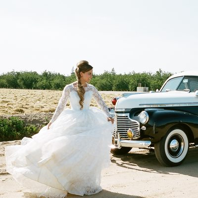 Bride with vintage police car