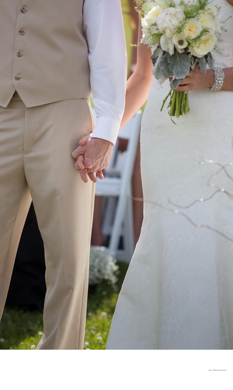 Bride & Groom Holding Hands   Outdoor Wedding Ceremony