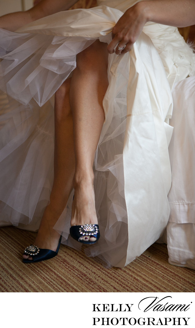 westchester bride adjusting dress blue wedding shoes