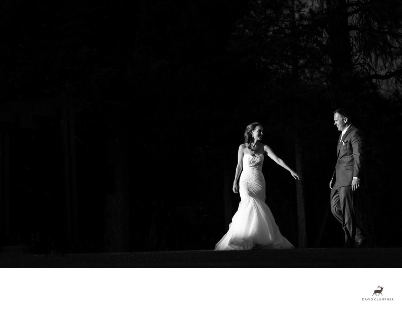 bride reaches for groom at holland lake lodge wedding