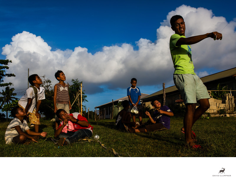 Tongan Boy Holds Kite While Friends Look On