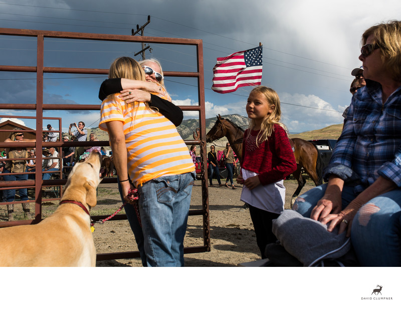 Friends Hug at Beginning of Gardiner Rodeo in Montana