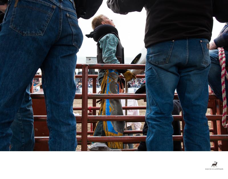 Young Cowboy Prepares for Bull Riding at Hamilton Rodeo