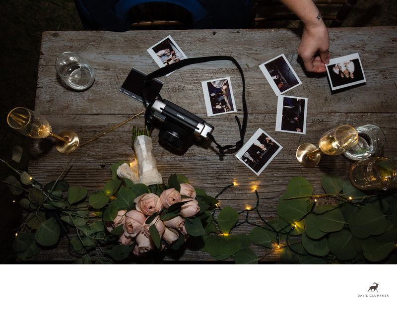 Guest Plays with Instax Camera at Montana Wedding