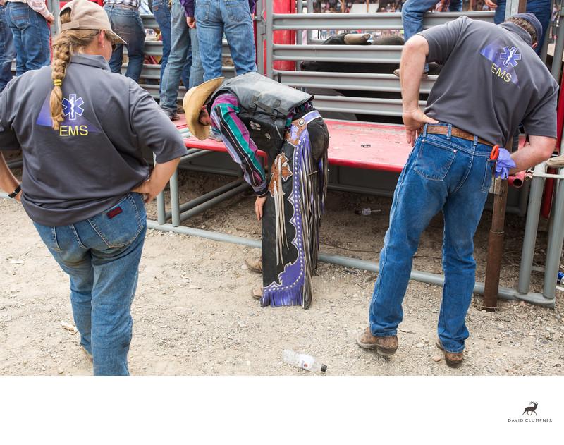 Injured Bronc Rider at Drummond, Montana Rodeo