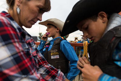 Cowboy Adjusts Mouth Guard Before Bull Ride in Montana