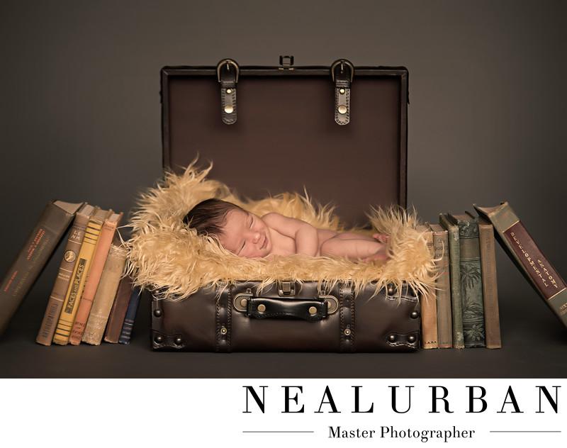 buffalo baby newborn photography ideas in suitcase boy books