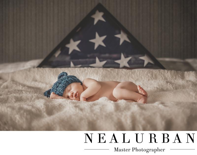 buffalo baby boy sleeping with grandfathers american flag