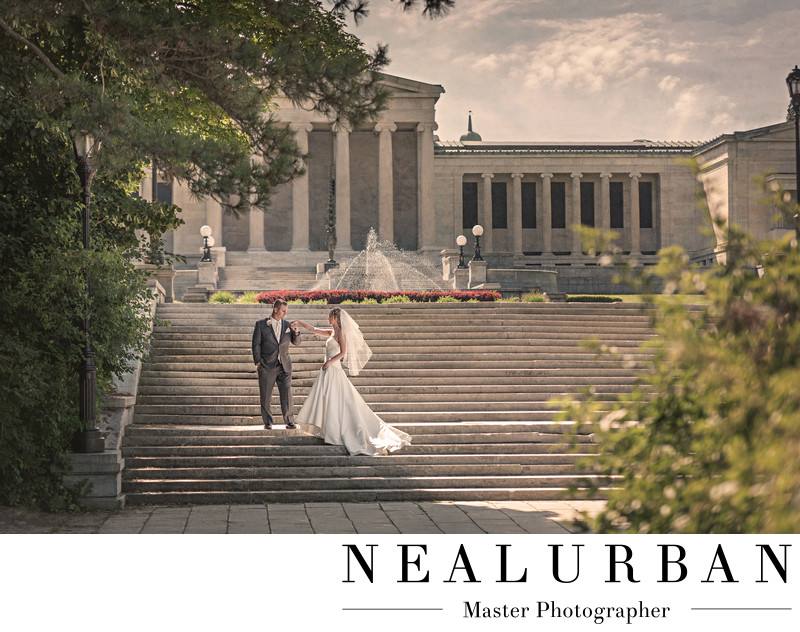Bride and groom on the stairs at delaware park with albright knox