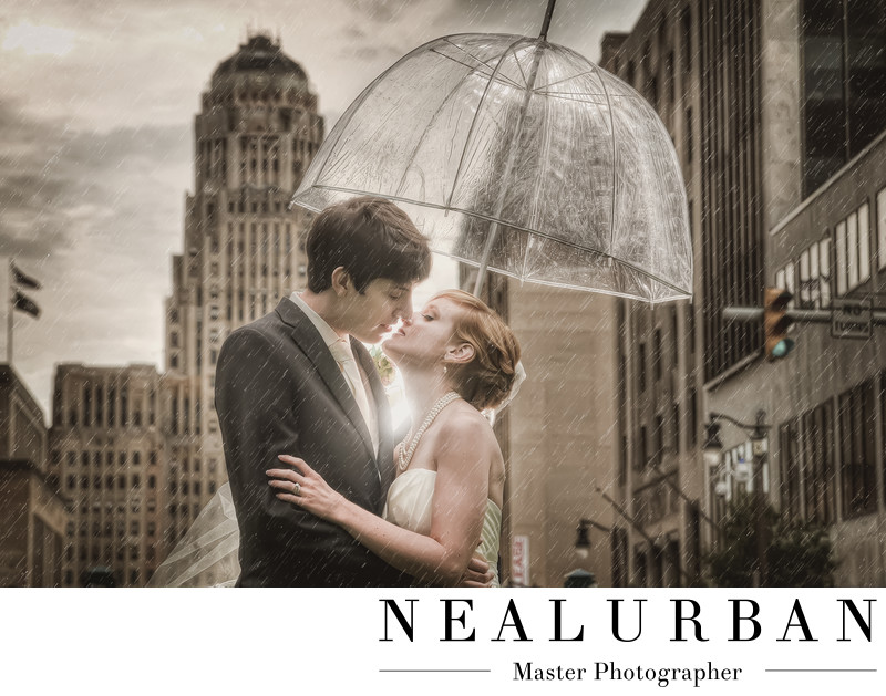 buffalo wedding photographers bride and groom in the rain umbrella