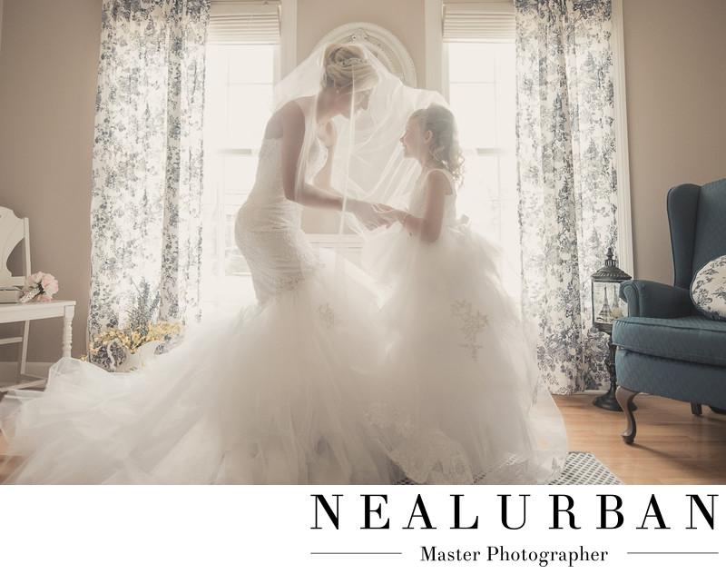 bride and flower girl under veil buffalo photographers