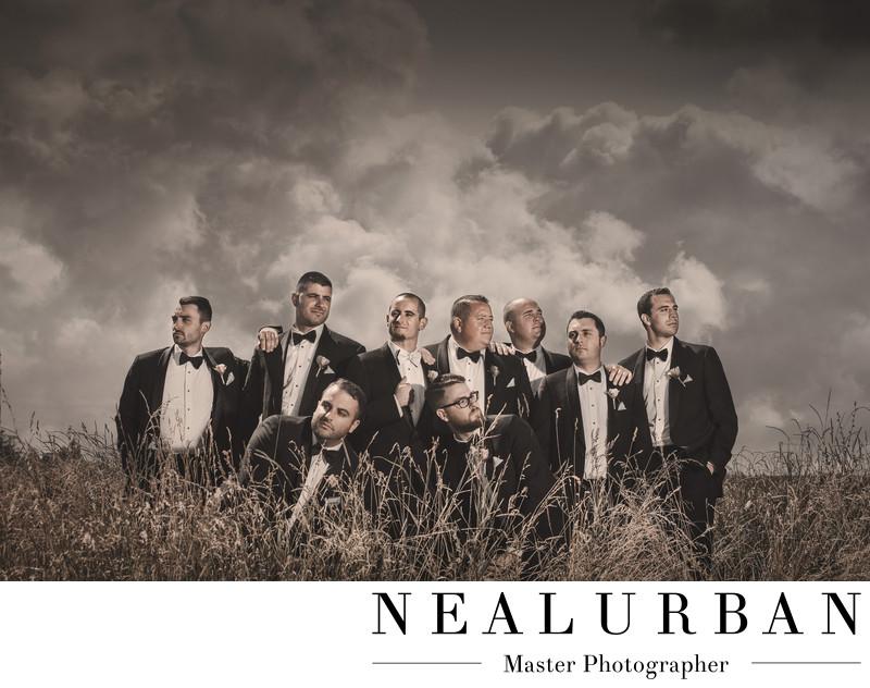 groomsmen buffalo country wedding pose field in tuxes