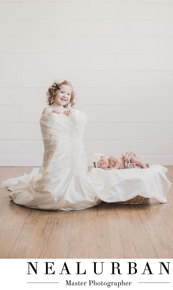 buffalo newborn photographers baby girl wedding dress