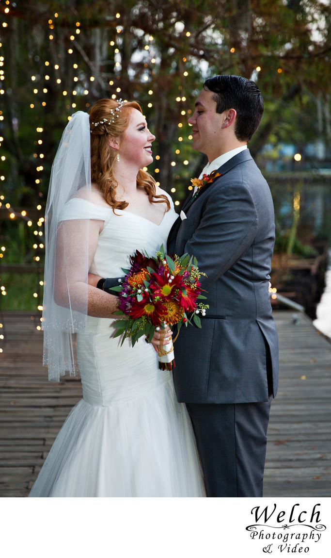 Bride groom red flowers Palmettos on the Bayou