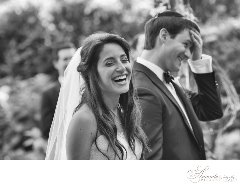 Bride and groom laugh during wedding ceremony The Royalton