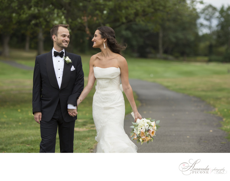 Bride and groom walking at Hampshire Country Club