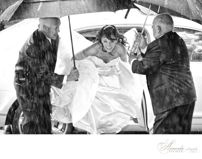 Bride exits limo in rain before wedding ceremony