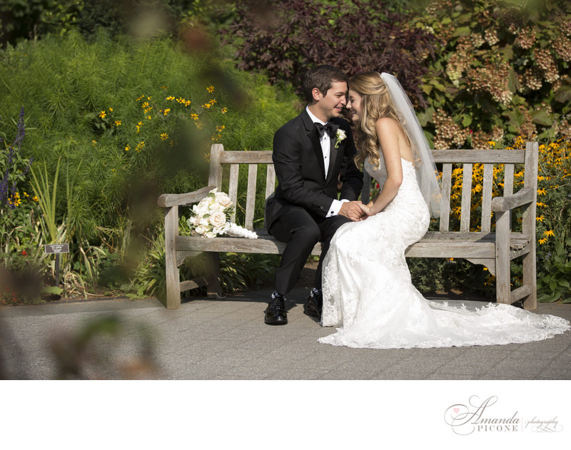 Bride and groom on bench at NY Botanical Garden