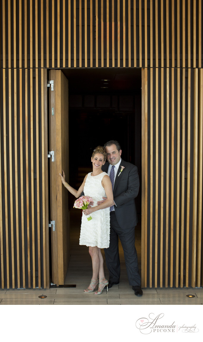 Bride and groom pose in doorway at Trump SoHo wedding