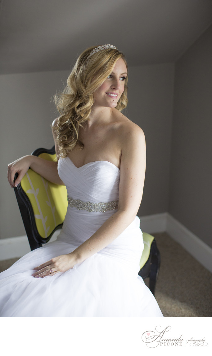 Bride sits in yellow chair New Jersey wedding