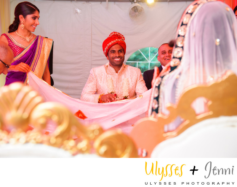 INDIAN WEDDING GROOM SMILING AT BRIDE - ULYSSES PHOTOGRAPHY