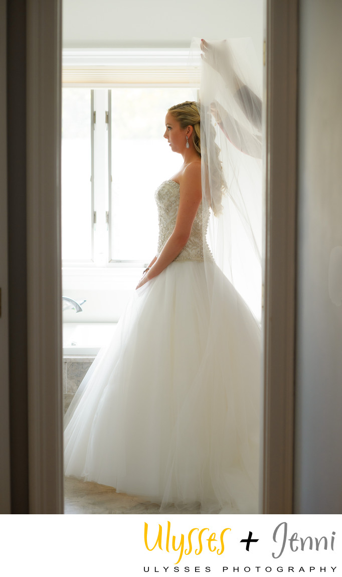 BRIDE FRAMED IN DOORWAY