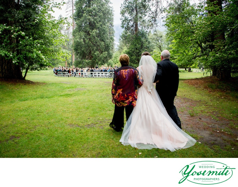 Bride Walks With Her Parents to Processional